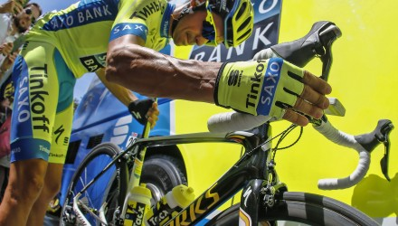 Race favorite Alberto Contador checks his bike before the start of Stage 5.