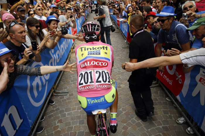 Champion-elect of the 2015 Giro d'Italia, Alberto Contador, rolls to the start line of the tour's finale on Stage 21.
