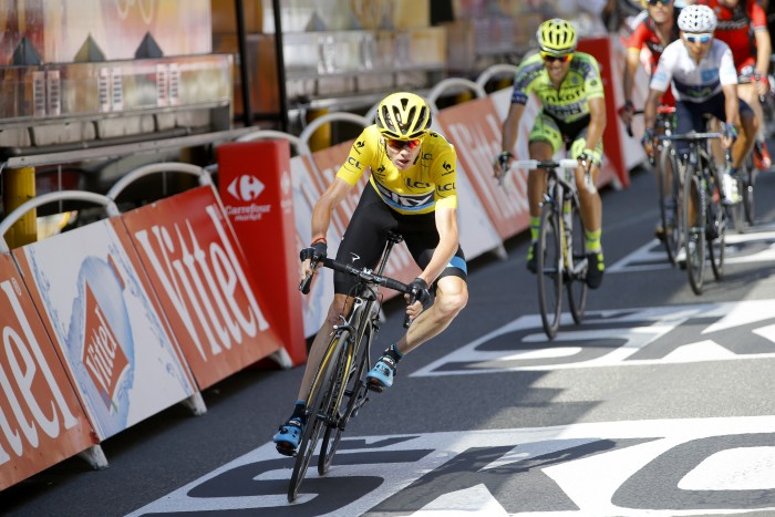 Chris Froome leads a group of the top GC contenders across the finish line on Stage 11.