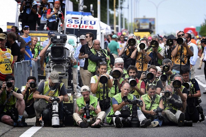 The photographers line up at the finish line waiting for the sprinters to compete for the stage victory.